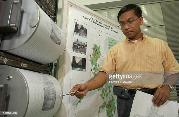 Renato Solidum director of the Philippine Institute of Volcanology and Seismology checks the recorded intensity of the 08 October 2004 earthquake on...