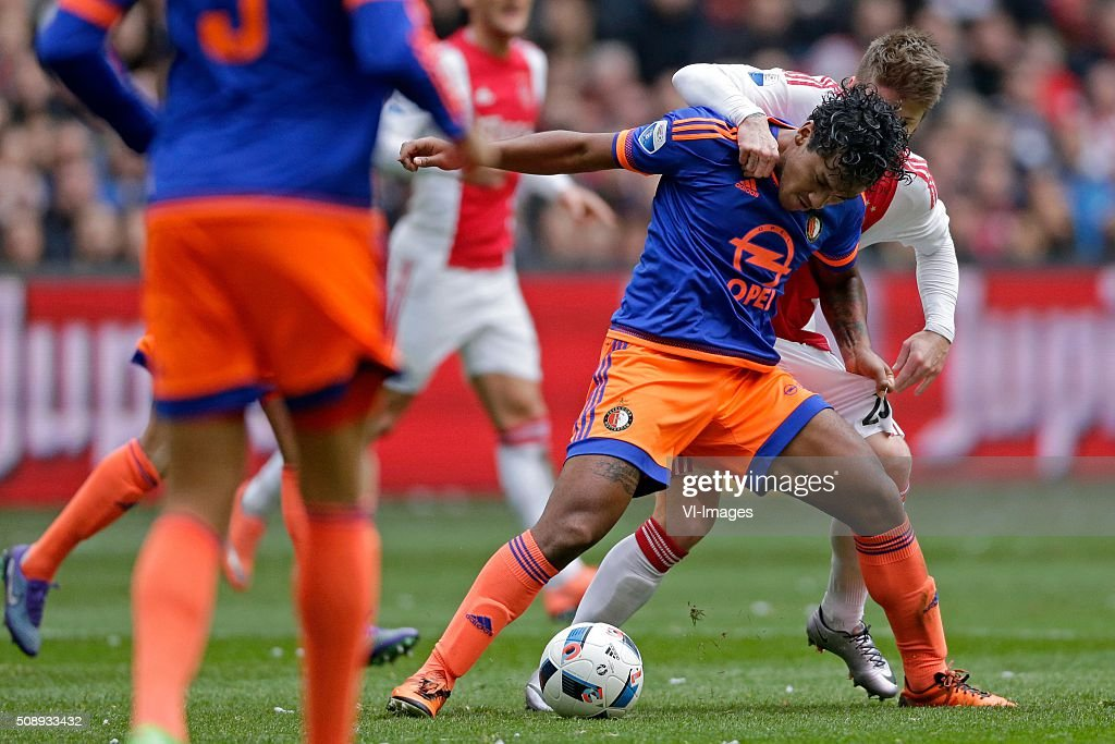 Renato Tapia of Feyenoord, Lasse Schone of Ajax during the Dutch Eredivisie match between Ajax Amsterdam and Feyenoord Rotterdam at the Amsterdam Arena on February 07, 2016 in Amsterdam, The Netherlands
