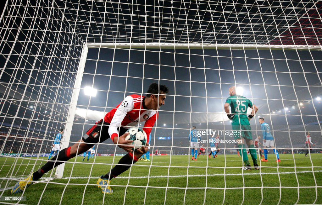 Renato Tapia of Feyenoord picks the ball out of the net after Jeremiah St. Juste of Feyenoord (bot pictured) scored his sides second goal during the UEFA Champions League group F match between Feyenoord and SSC Napoli at Feijenoord Stadion on December 6, 2017 in Rotterdam, Netherlands.