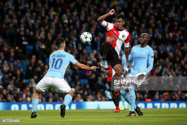 Renato Tapia of Feyenoord takes on Sergio Aguero of Manchester City during the UEFA Champions League group F match between Manchester City and...