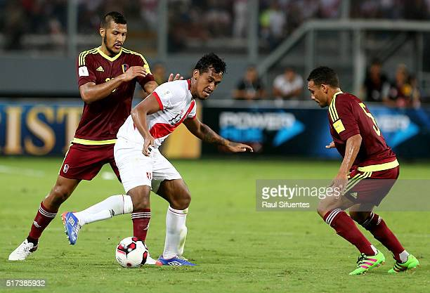 Renato Tapia of Peru struggles for the ball with Arquimedes Figuera of Venezuela during a match between Peru and Venezuela as part of FIFA 2018 World...