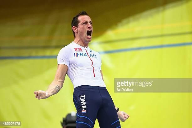 Renaud Lavillenie of France celebrates a jump in the Men's Pole Vault Final during day two of the 2015 European Athletics Indoor Championships at O2...