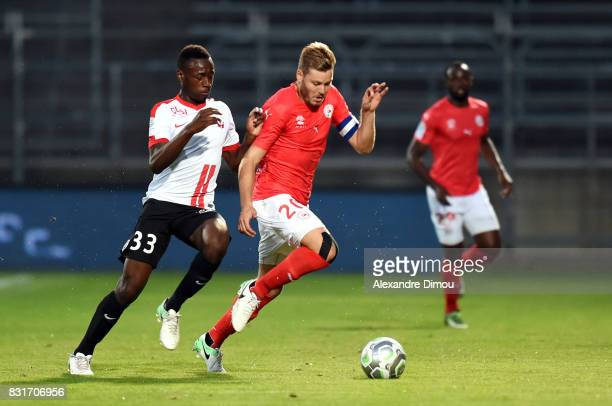 Renaud Ripart of Nimes and Abou Ba of Nancy during the Ligue 2 match between Nimes Olympique and As Nancy Lorraine at Stade des Costieres on August...