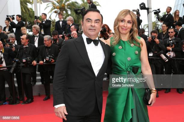 Renault CEO Carlos Ghosn and his wife Carole Ghosn attend 'Amant Double ' Red Carpet Arrivals during the 70th annual Cannes Film Festival at Palais...
