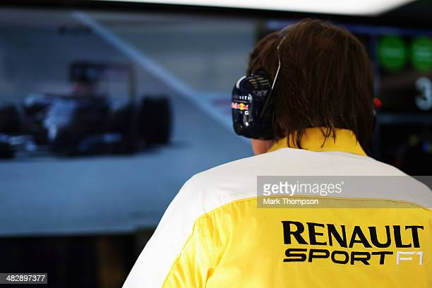 Renault engineer is seen in the Infinii Red Bull Racing mechanics garage during the final practice session prior to qualifying for the Bahrain...