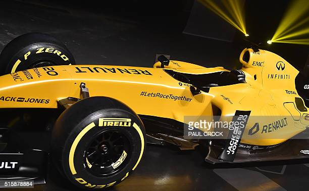 A Renault Formula One car in 2016 livery is unveiled at Docklands ahead of the Australian Formula One Grand Prix in Melbourne on March 16 2016 / AFP...
