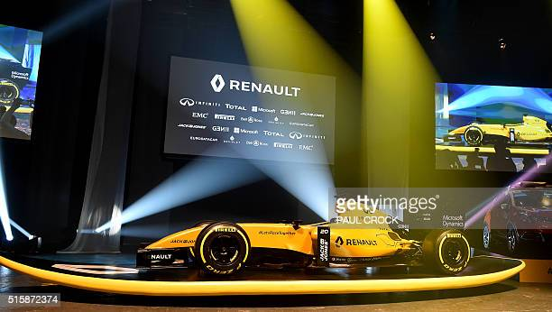 A Renault Formula One car in 2016 livery is unveiled on a giant surfboard at Docklands ahead of the Australian Formula One Grand Prix in Melbourne on...