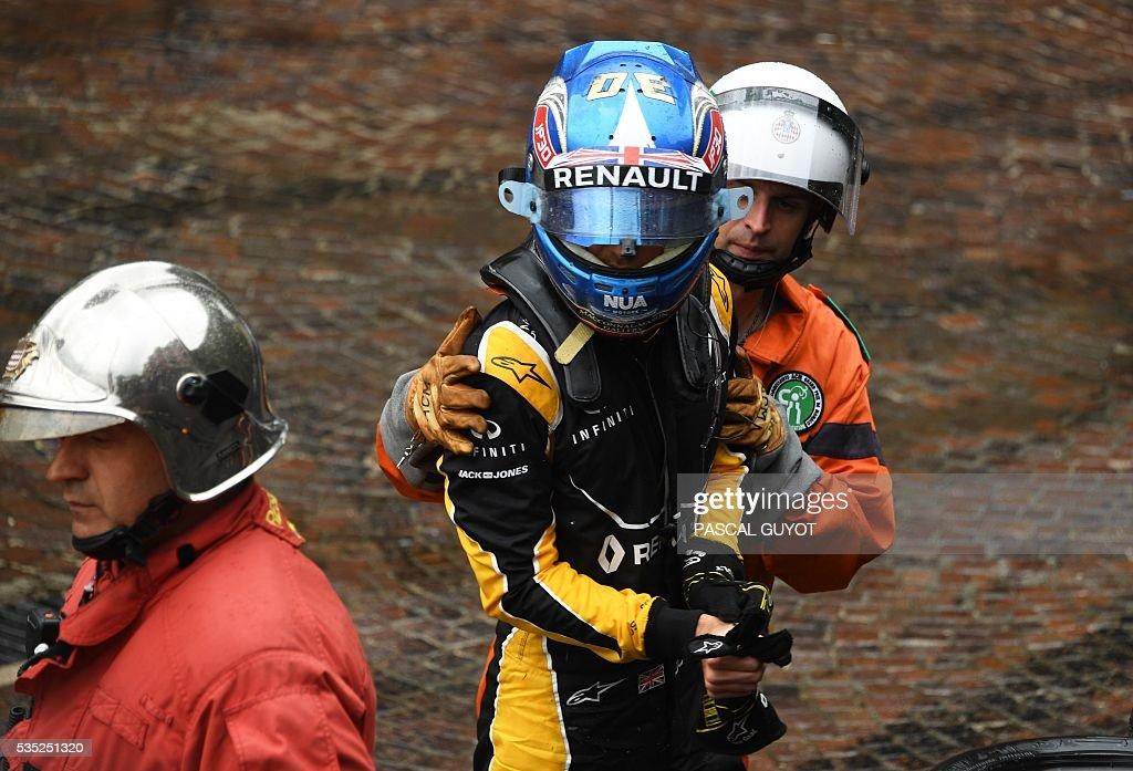 Renault Sport F1 Team's British driver Jolyon Palmer is evacuated after he crashed during the start at the Monaco street circuit, on May 29, 2016 in Monaco, during the Monaco Formula 1 Grand Prix. / AFP / PASCAL
