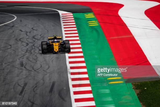 TOPSHOT Renault's British driver Jolyon Palmer drives his car during the first practice session of the Formula One Austria Grand Prix at the Red Bull...