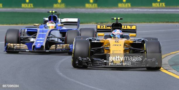 Renault's British driver Jolyon Palmer leads Sauber's German driver Pascal Wehrlein through a corner during the first practice session at the Formula...