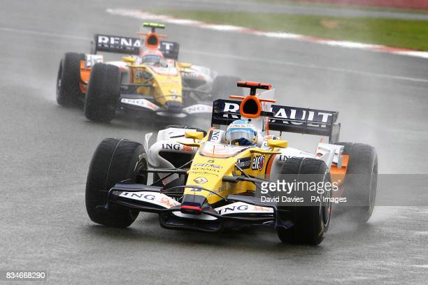 Renault's Fernando Alonso leads team mate Renault's Nelsinho Piquet through a chicane during the British Grand Prix at Silverstone Northamptonshire