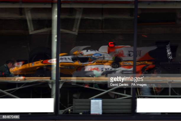 Renault's Fernando Alonso's car is reflected in a window during qualifying for the British Grand Prix at Silverstone Northamptonshire