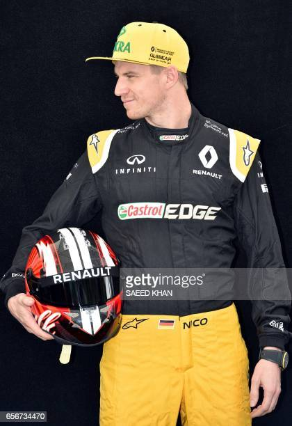 Renault's German driver Nico Hulkenberg poses for a photo in Melbourne on March 23 ahead of the Formula One Australian Grand Prix / AFP PHOTO / Saeed...
