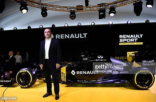 Renault's president Carlos Ghosn poses next to the Renault's RS16 after the company's press conference at the Renault's technocentre in Guyancourt...