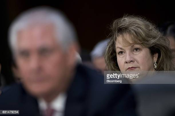 Renda St Clair listens as her husband Rex Tillerson former chief executive officer of Exxon Mobil Corp and US secretary of state nominee for...