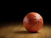 3D rendering basketball ball on wooden floor.