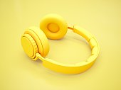 3D Rendering Yellow headphones isolated on yellow background.
