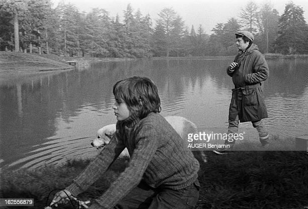 Rendezvous With Alain Delon For Its 41St Birthday Alain DELON en bottes canadienne et casquette se promenant sur les bords du lac artificiel de sa...
