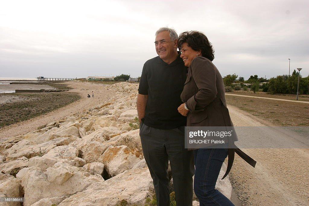 Rendezvous With <a gi-track='captionPersonalityLinkClicked' href=/galleries/search?phrase=Dominique+Strauss-Kahn&family=editorial&specificpeople=227268 ng-click='$event.stopPropagation()'>Dominique Strauss-Kahn</a> And Anne Sinclair. Dominique STRAUSS-KAHN et son épouse Anne SINCLAIR riant, se promenant sur la plage d'Ayrte en marge de l'Université d'été du Ps à La Rochelle. .