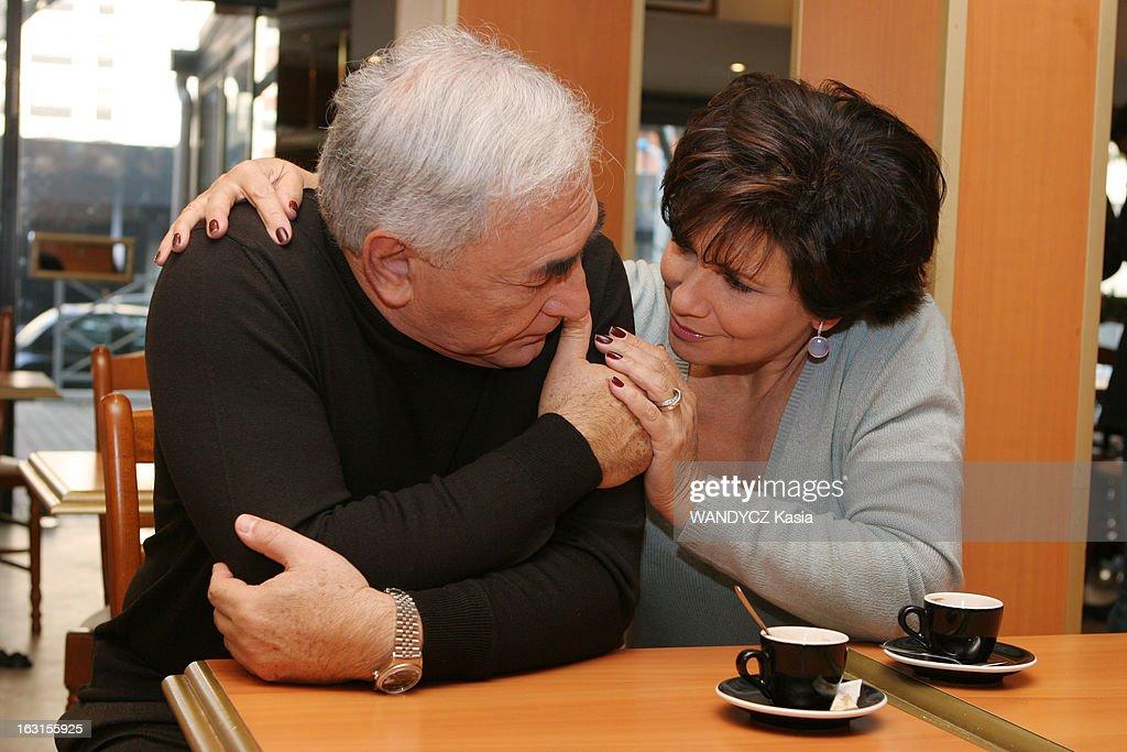 Rendezvous With <a gi-track='captionPersonalityLinkClicked' href=/galleries/search?phrase=Dominique+Strauss-Kahn&family=editorial&specificpeople=227268 ng-click='$event.stopPropagation()'>Dominique Strauss-Kahn</a> In Sarcelles. Attitude de trois-quarts de Dominique STRAUSS-KAHN et son épouse Anne SINCLAIR se regardant en se tenant la main, assis à une table devant un café au bar 'Aux délices' de SARCELLES dont il est adjoint au maire..