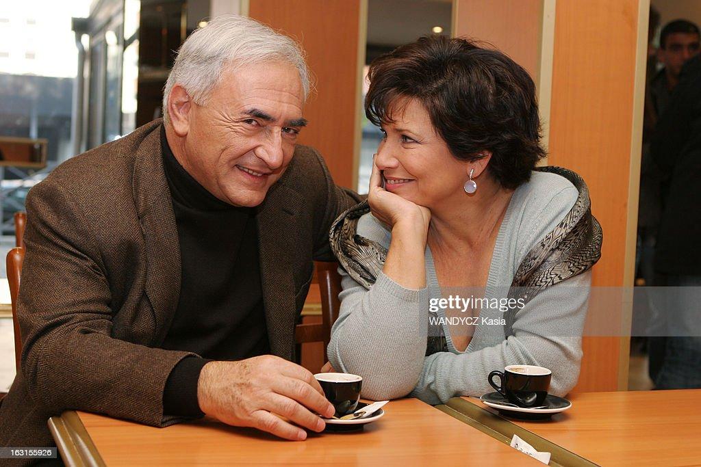 Rendezvous With <a gi-track='captionPersonalityLinkClicked' href=/galleries/search?phrase=Dominique+Strauss-Kahn&family=editorial&specificpeople=227268 ng-click='$event.stopPropagation()'>Dominique Strauss-Kahn</a> In Sarcelles. Attitude souriante d'Anne SINCLAIR de profil regardant son mari Dominique STRAUSS-KAHN, tous deux assis à une table devant un café au bar 'Aux délices' de SARCELLES dont il est adjoint au maire..