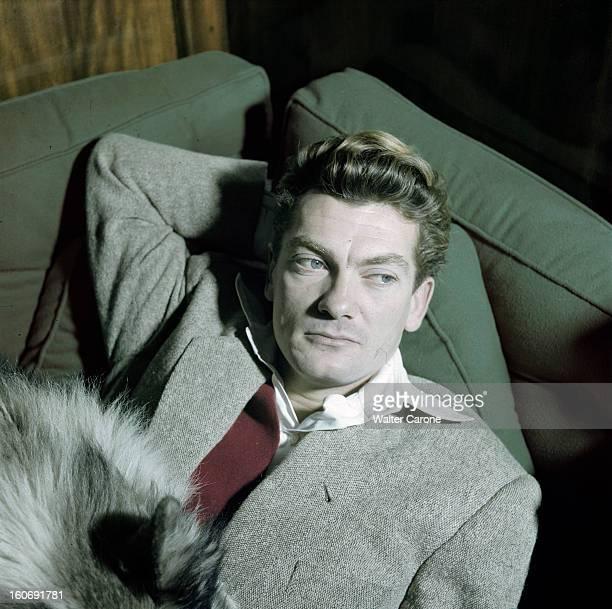 Rendezvous With Jean Marais En novembre 1949 portrait de l'acteur Jean MARAIS en veste grise et gilet rouge allongé en compagnie d'un chien