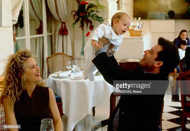 Rendezvous With John Travolta John TRAVOLTA en famille au Trianon Palace de Versailles l'acteur soulevant dans ses bras son fils Jett sous le regard...