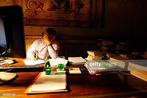 Rendezvous With The Henri Guaino At The Elysee Attitude d'Henri GUAINO une main sur le front dans son bureau au palais de l'Elysée à PARIS...