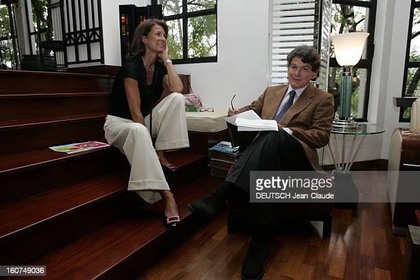 Rendezvous With Thierry Breton At Home In Paris Attitude souriante de Thierry BRETON assis sur un fauteuil des feuilles à la main avec son épouse...