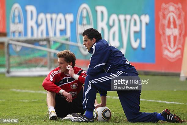 Rene Adler and Benedikt Fernandez look on during the training session of Bayer Leverkusen at the training ground on April 27 2010 in Leverkusen...