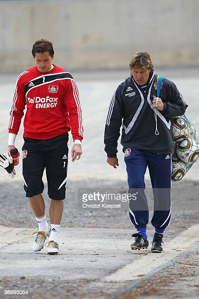Rene Adler and goalkeeper coach Ruediger Vollborn walk to the training session of Bayer Leverkusen at the training ground on April 27 2010 in...