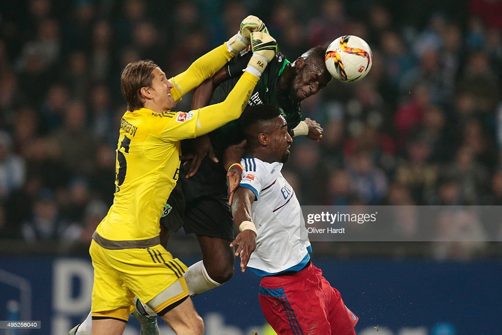 Rene Adler and Johan Djourou (L-R) of Hamburg and Salif Sane (C) of Hannover compete for the ball during the First Bundesliga match between Hamburger SV and Hannover 96 at Volksparkstadion on November 1, 2015 in Hamburg, Germany.