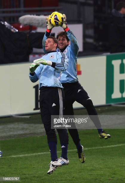 Rene Adler and Manuel Neuer of Germany in action during a training session on the eve of their friendly international match against the Netherlands...