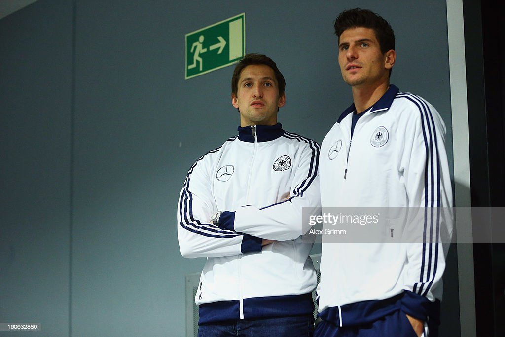 Rene Adler (L) and Mario Gomez wait for a Germany press conference at Commerzbank-Arena on February 4, 2013 in Frankfurt am Main, Germany.