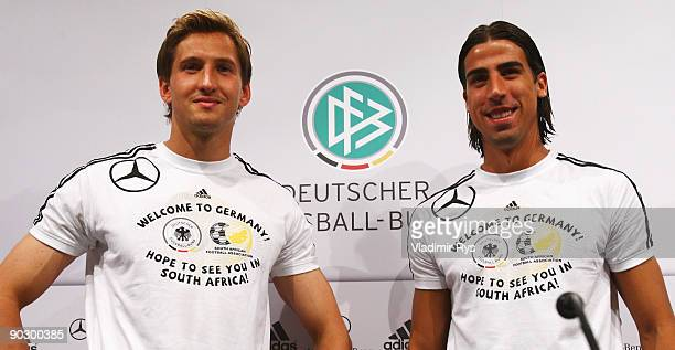 Rene Adler and Sami Khedira dressed in a Adidas tshirts saying 'Welcome to Germany hope to see you in South Africa' pose for a photo during the...