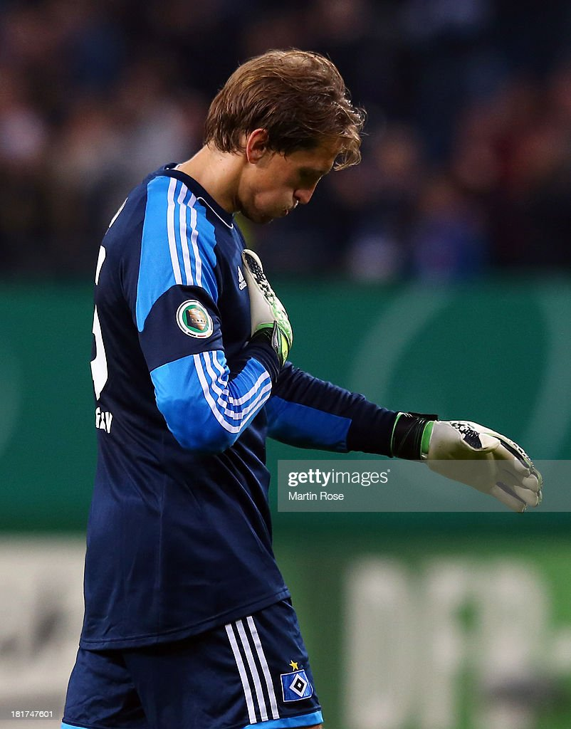 <a gi-track='captionPersonalityLinkClicked' href=/galleries/search?phrase=Rene+Adler&family=editorial&specificpeople=686184 ng-click='$event.stopPropagation()'>Rene Adler</a>, goalkeeper of Hamburg reacts after the DFB Cup second round match between Hamburger SV and Greuther Fuerth at Imtech Arena on September 24, 2013 in Hamburg, Germany.