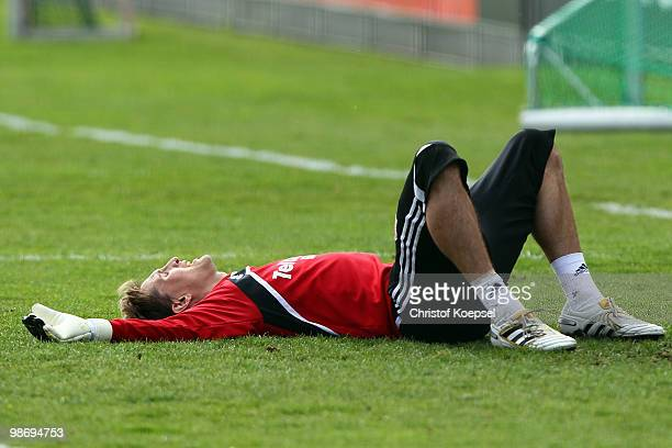 Rene Adler lies on the pitch during the training session of Bayer Leverkusen at the training ground on April 27 2010 in Leverkusen Germany