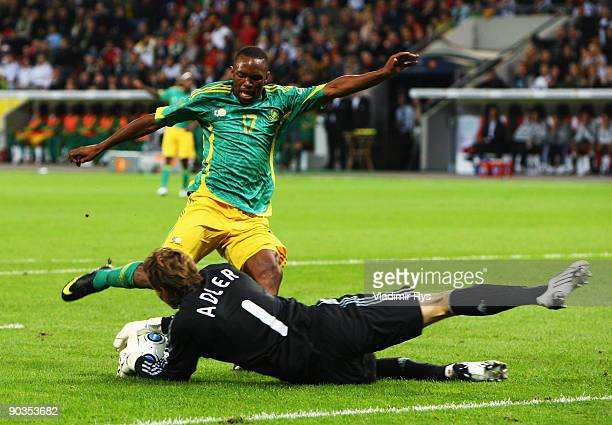 Rene Adler of Germany saves the ball against Bernard Parker of South Africa during the international friendly match between Germany and South Africa...