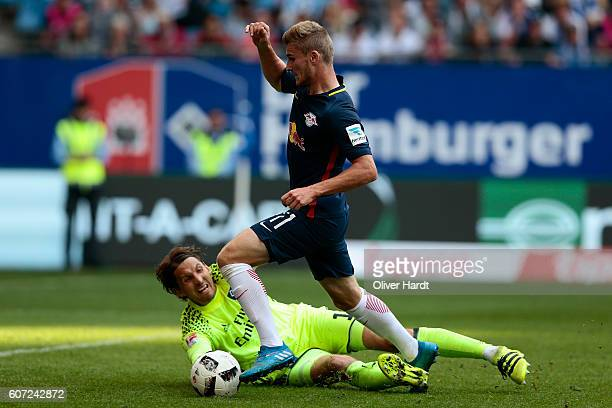 Rene Adler of Hamburg and Timo Werner of Leipzig compete for the ball during the Bundesliga match between Hamburger SV and RB Leipzig at...