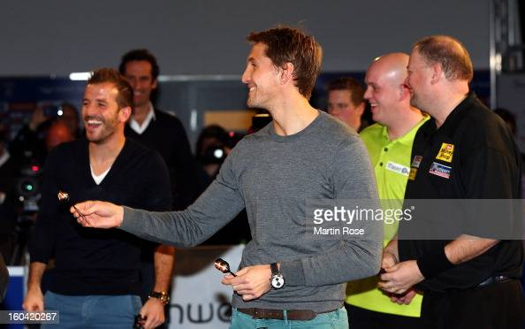 Rene Adler of Hamburg in action during a dart show tournament at between team Netherlands and Hamburger SV at Imtech Arena on January 31 2013 in...