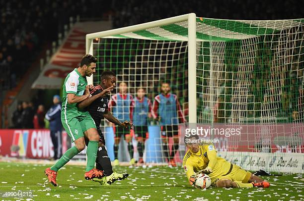 Rene Adler of Hamburg makes a save from a chance by Claudio Pizarro of Bremen during the Bundesliga match between Werder Bremen and Hamburger SV at...