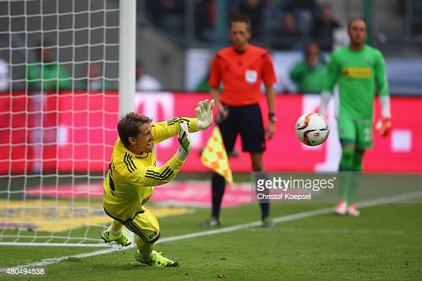 Rene Adler of Hamburg saves the decision penalty against Nico Elvedi of Moenchengladbach during the Telekom Cup 2015 Semi Final match between...