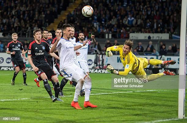 Rene Adler of Hamburger SV makes a save against Sandro Wagner of SV Darmstadt 98 during the first bundesliga match between SV Darmstadt 98 and...