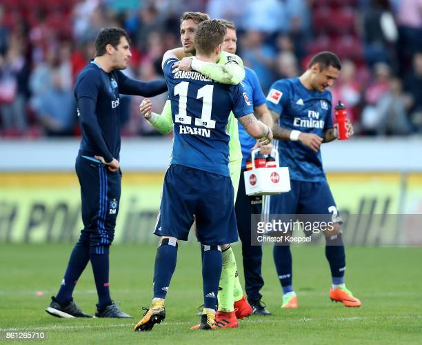 Rene Adler of Mainz embraces Andre Hahn of Hamburger SV after the Bundesliga match between 1 FSV Mainz 05 and Hamburger SV at Opel Arena on October...