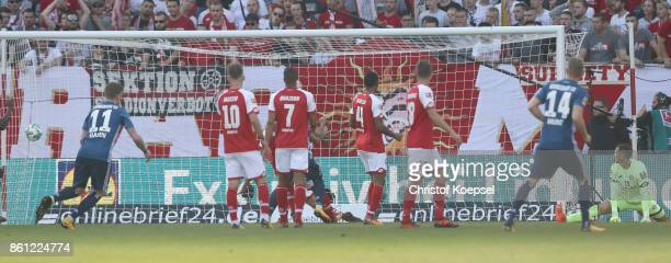 Rene Adler of Mainz gest a goal of Walace of Hamburger SV during the Bundesliga match between 1 FSV Mainz 05 and Hamburger SV at Opel Arena on...