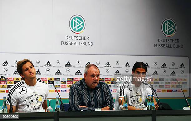 Rene Adler press officer Harald Stenger and Sami Khedira attend the German Football National Team press conference at the Guerzenich Koeln on...
