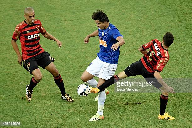 Rene and Wendel of Sport Recife struggles for the ball with Marcelo Moreno a of Cruzeiro during a match between Sport Recife and Cruzeiro as part of...