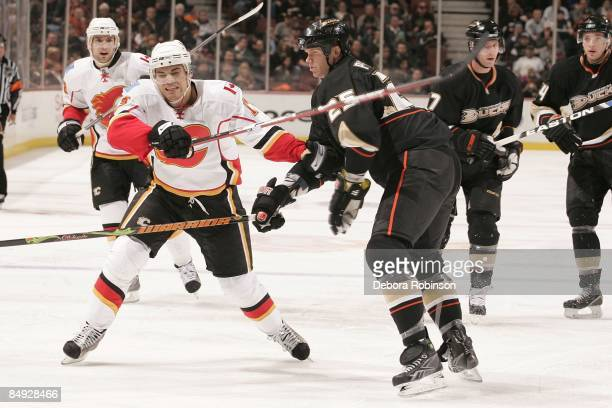 Rene Bourque of the Calgary Flames fights for position against Chris Pronger of the Anaheim Ducks during the game on February 11 2009 at Honda Center...