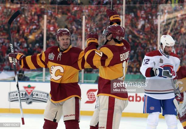 Rene Bourque of the Calgary Flames scores a power play goal at 809 of the first period and is joined by Olli Jokinen in first period action against...