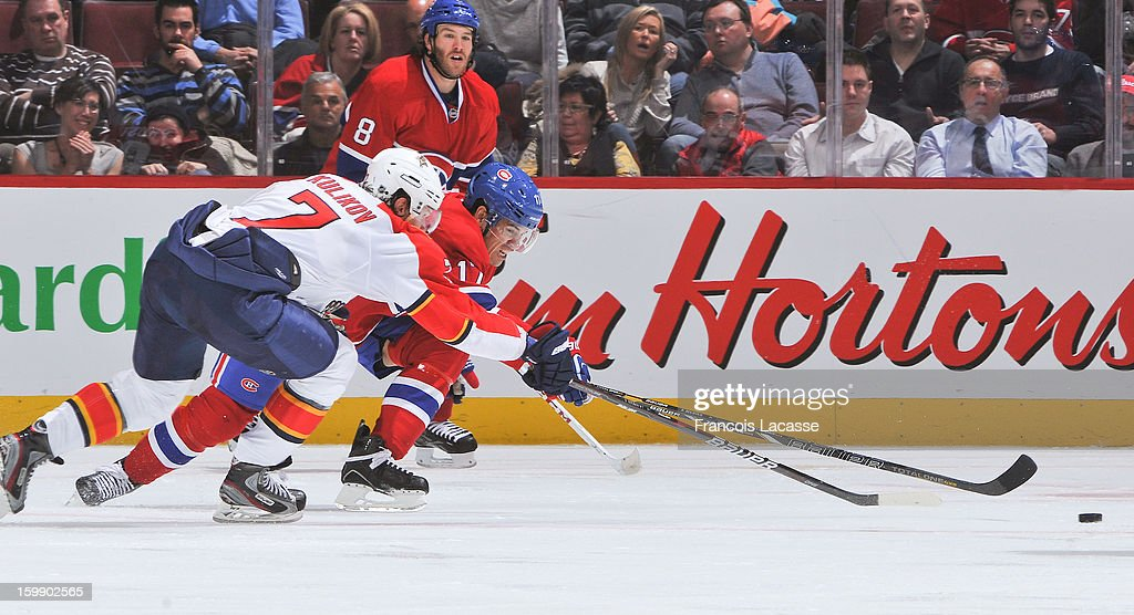 <a gi-track='captionPersonalityLinkClicked' href=/galleries/search?phrase=Rene+Bourque&family=editorial&specificpeople=685715 ng-click='$event.stopPropagation()'>Rene Bourque</a> #17 of the Montreal Canadiens and Dmitry Kulikov #7of the Florida Panthers race for the puck during the NHL game on January 22, 2013 at the Bell Centre in Montreal, Quebec, Canada.